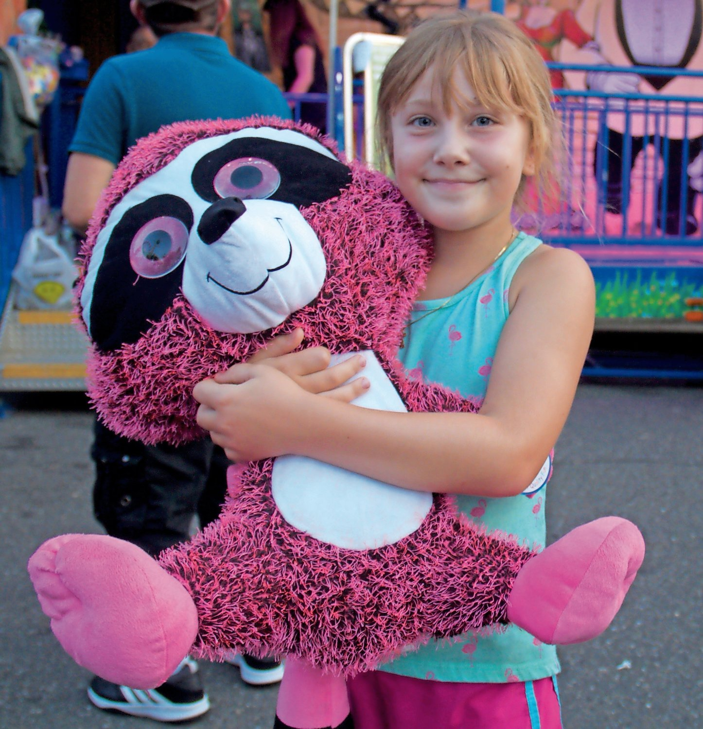 Grace Niver, 8, was proud of her giant prize raccoon.