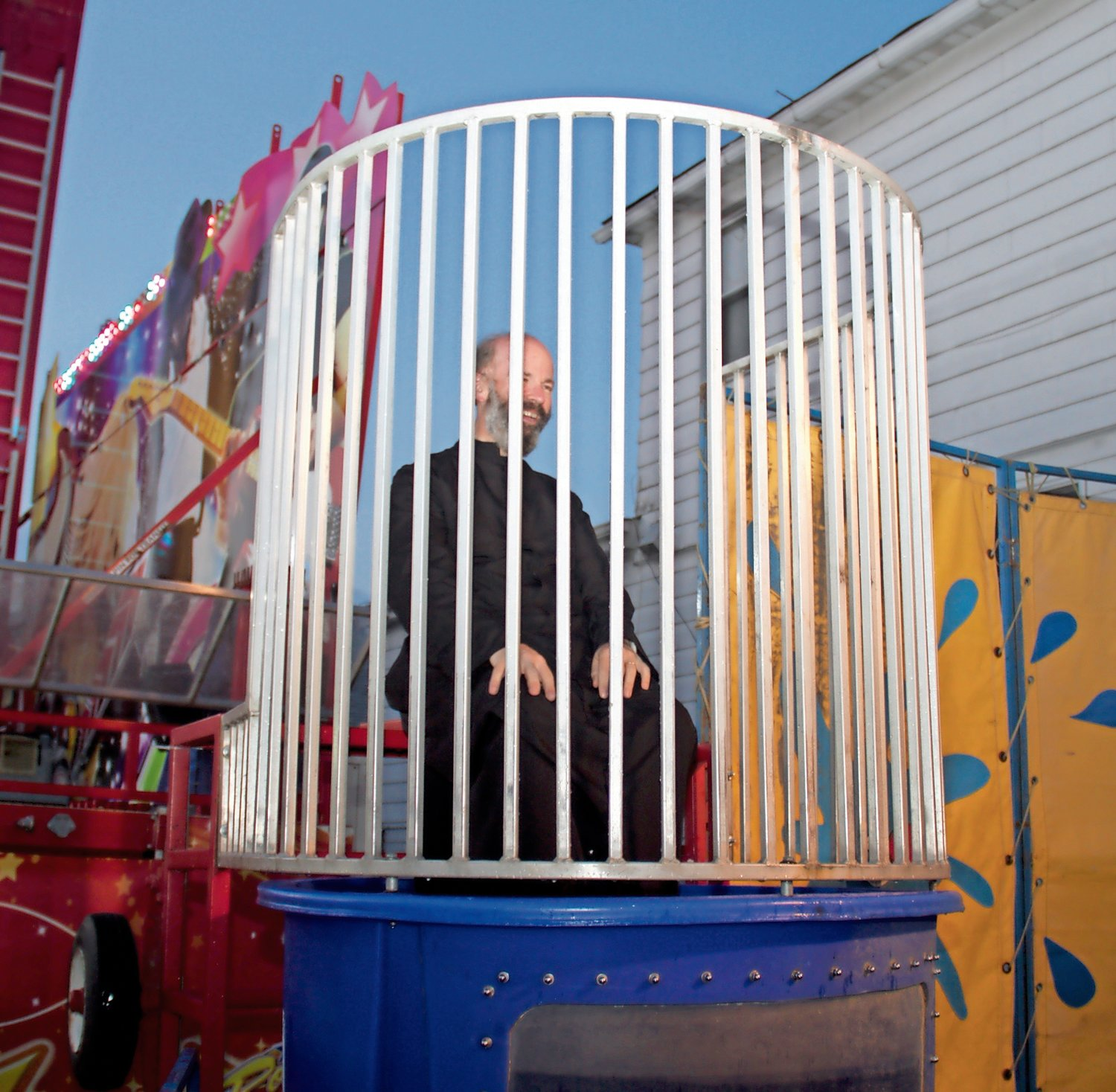 Father Daniel of St. Rocco's Church challenged feast-goers to drop him into the dunk tank.