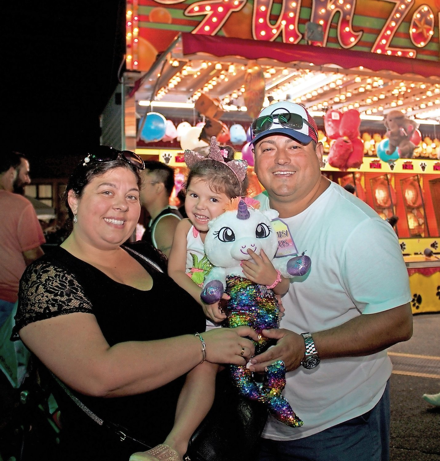 Silvana, left, and Adrian Campodonico brought their daughter Valentina, 3, to enjoy the feast as a family.