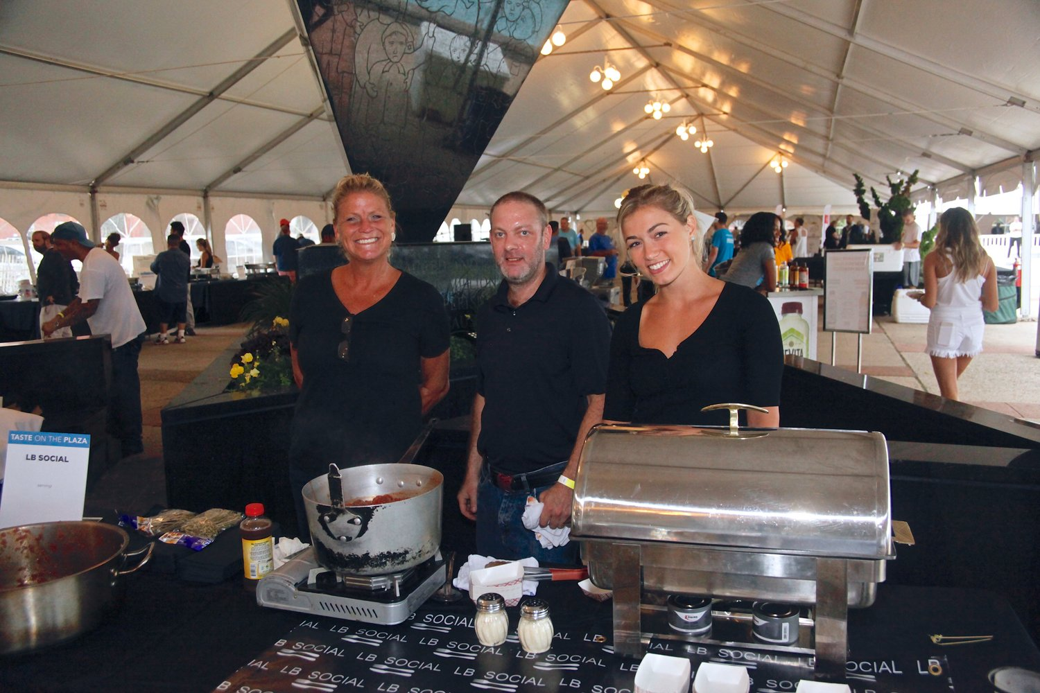 "Mindy Collins, Left, Brian Connelly and Gina Crescimmano from LB Social sampled their meatballs during ""Taste on the Plaza"""
