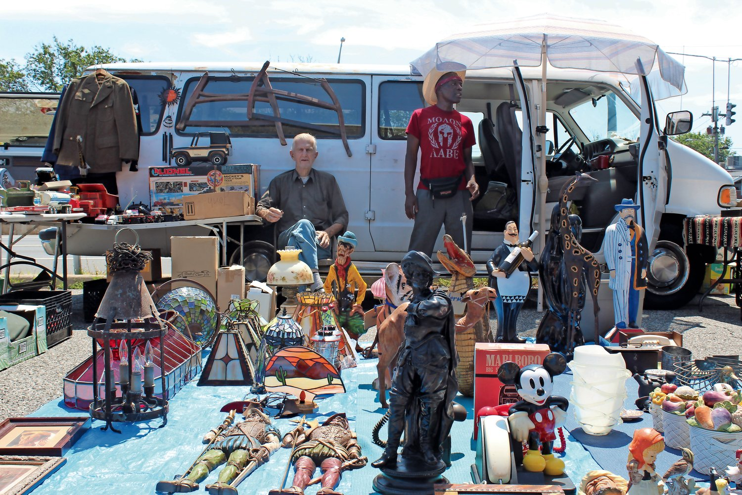 Lou Prantmeyer, left, and Kenneth Line, of Amityville, sold a wide variety of valuables at the flea market, including picture frames, statuettes, toys, stained-glass lampshades and more.