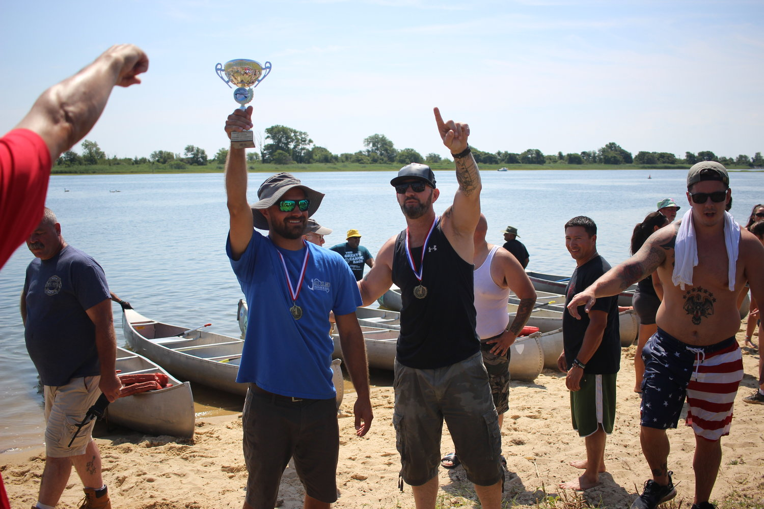 Racers Joe Micciulli, left, and Rob Weltner celebrated their first place win for their company All Island Dock Builders during the local business race.