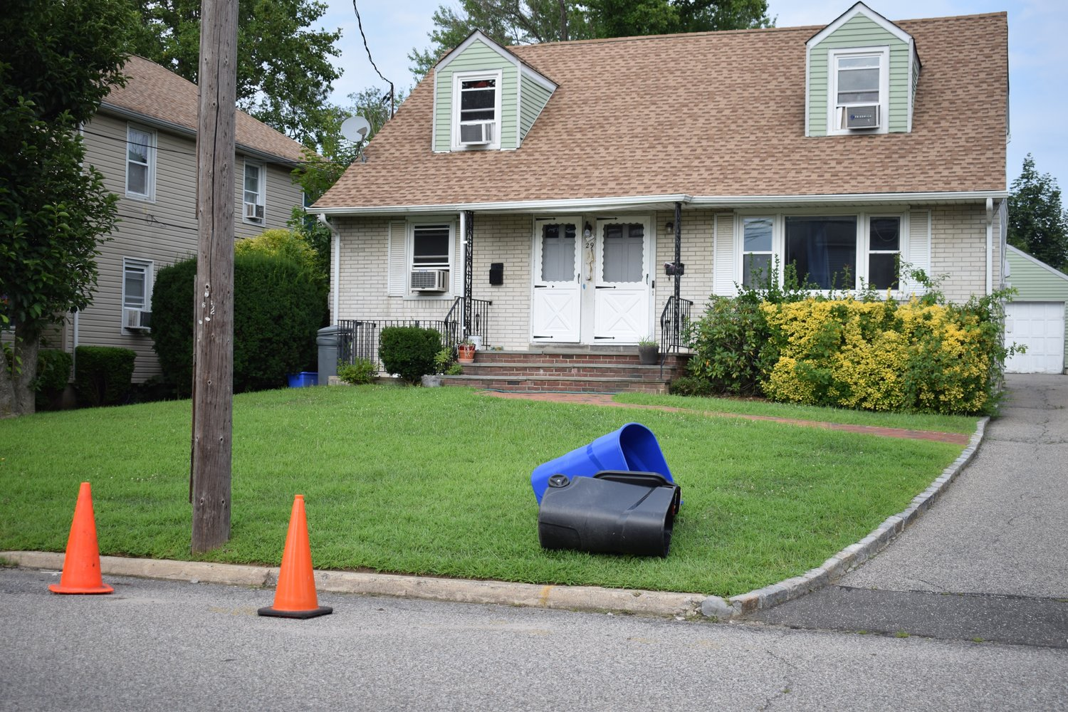 Residents along Nassau Avenue put cones out to save their parking spots.