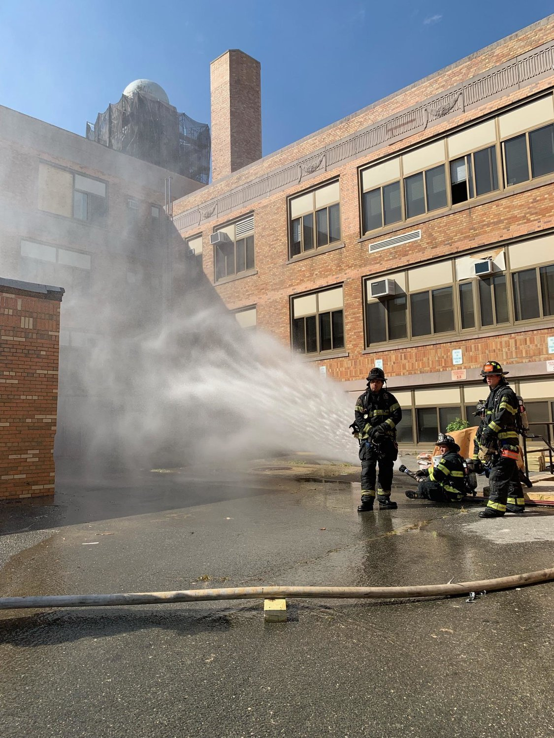 Valley Stream firefighters sprayed the source of a natural gas leak at Central High School with water to dissipate the fumes.