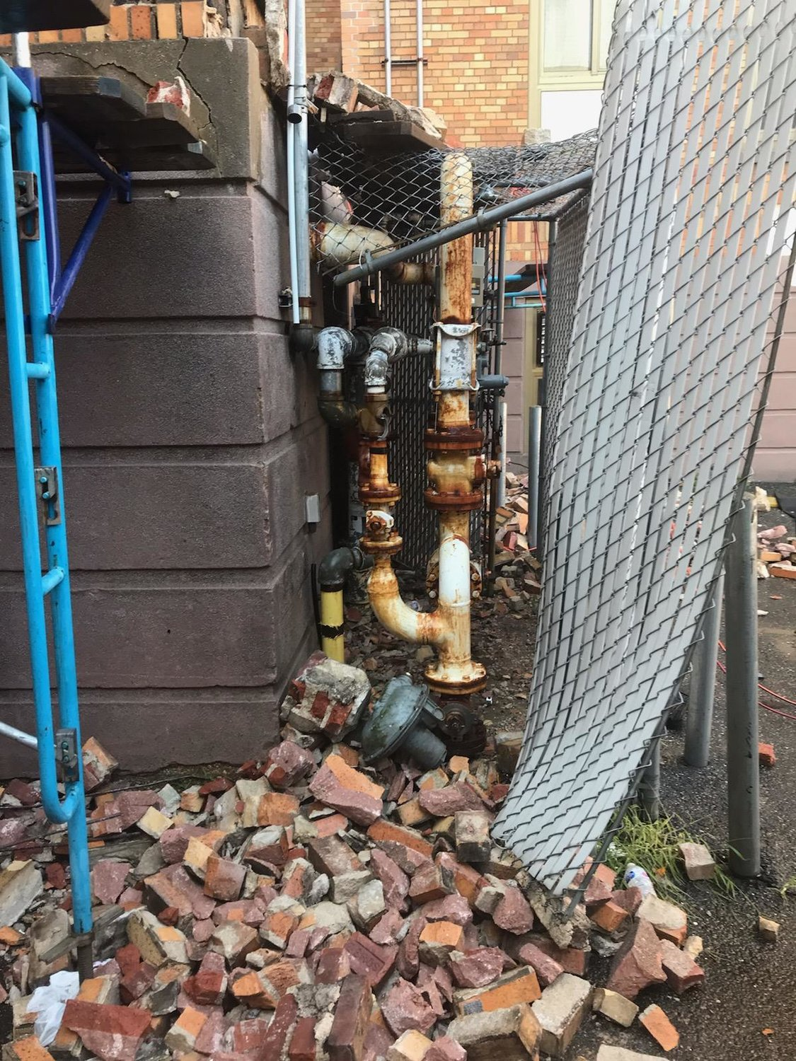 Fire officials reported that falling bricks due to construction had hit the gas regulator at the rear of the building, breaking it off and causing gas to spew out.