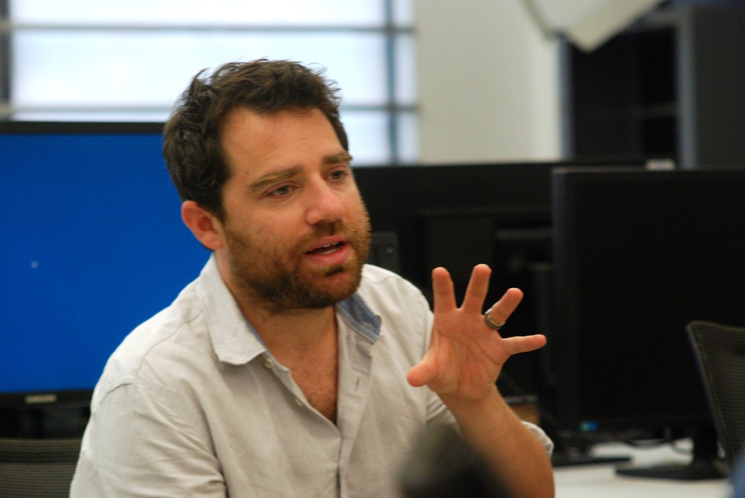 Author Michael Otterman, formerly of Merrick and Old Westbury, stopped by the Hofstra University Summer High School Journalism Institute on July 29 to discuss journalism with participants.