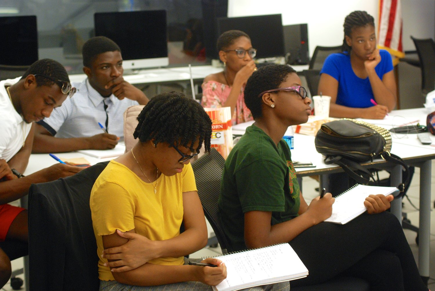 Participants taking notes during Otterman's presentation. Students came to the Summer Institute from Elmont and Freeport high schools.