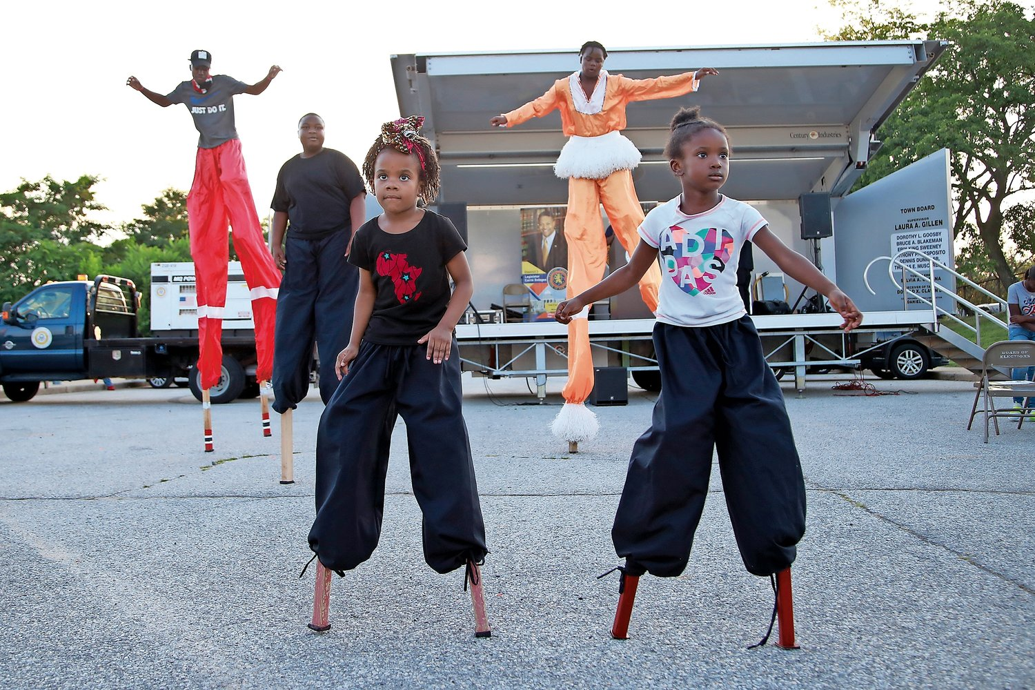 Stilt dancers from Layla's Dance and Drum — clockwise from top left, Shane Collins-Bowen, 16; MJ Nelson, 12; Nyles Adams, 17; and Leilani Theus and Arielle Cohen, both 5 — entertained the crowd at the Elmont National Night Out on Aug. 6.