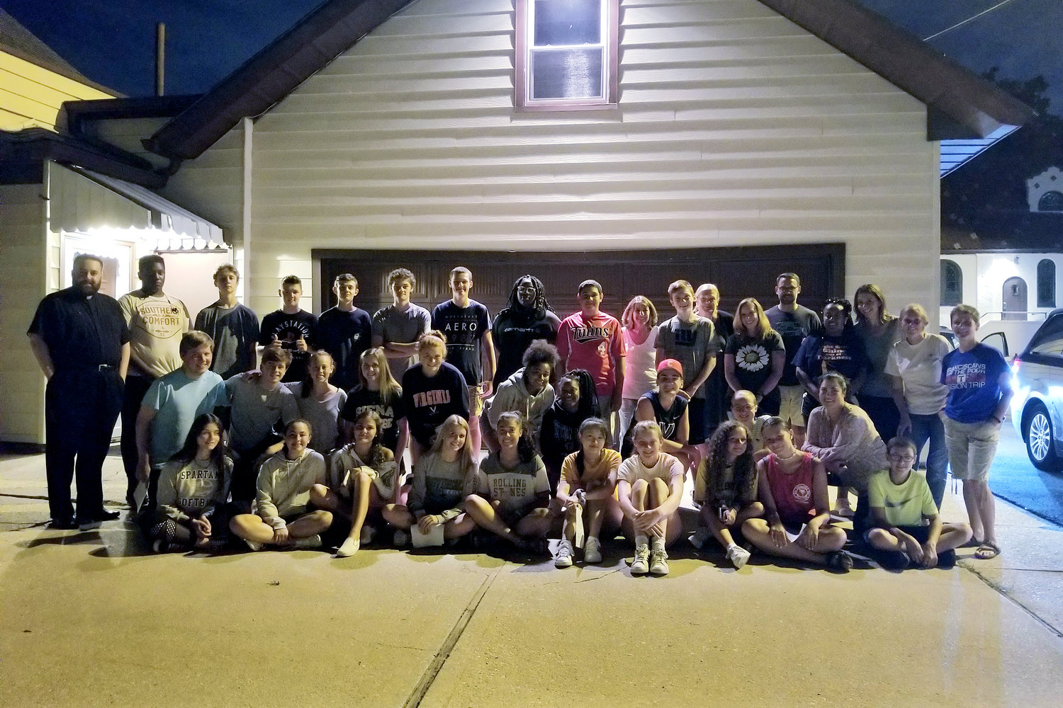 Teens and adults gathered at Our Lady of Lourdes Church before to heading into the city for their second Midnight Run of the year on Aug. 1.