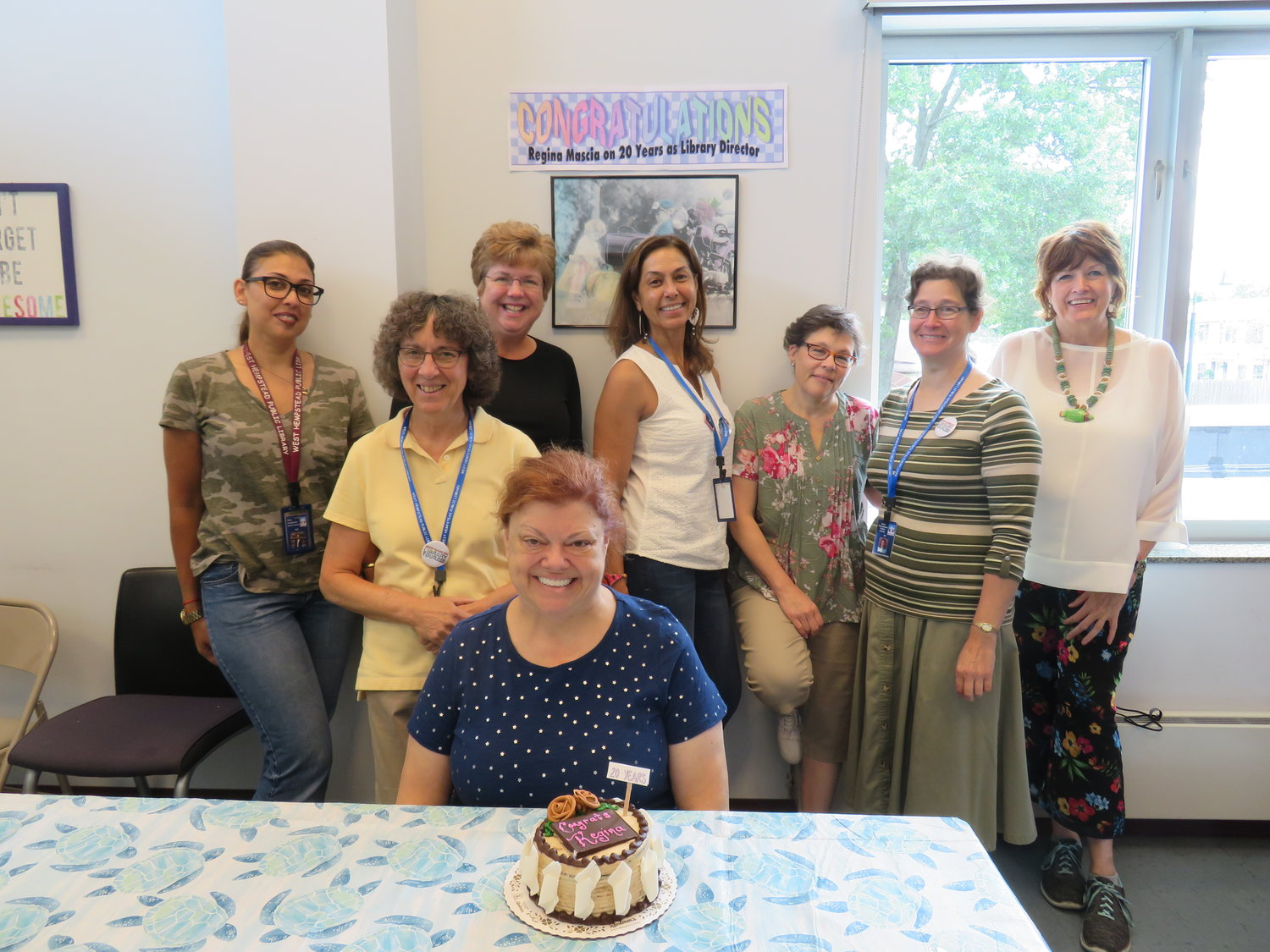 West Hempstead Library Director Regina Mascia celebrated her 20th anniversary in her position with staff members on Aug. 2.