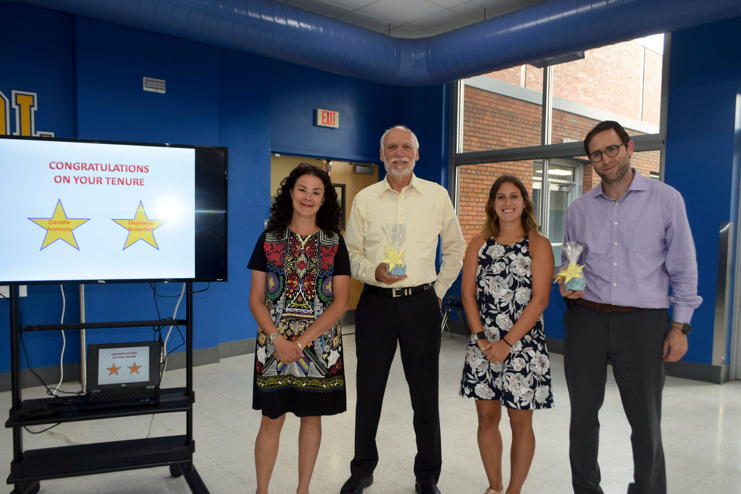 Lawrence School District teachers Danielle Aronovitz, left, and Stephanie Rubenfeld, were recognized at the Aug. 5 Board of Education for earning tenure. Trustees Michael Hatten, second from left, and Abel Feldhamer congratulated the educators.