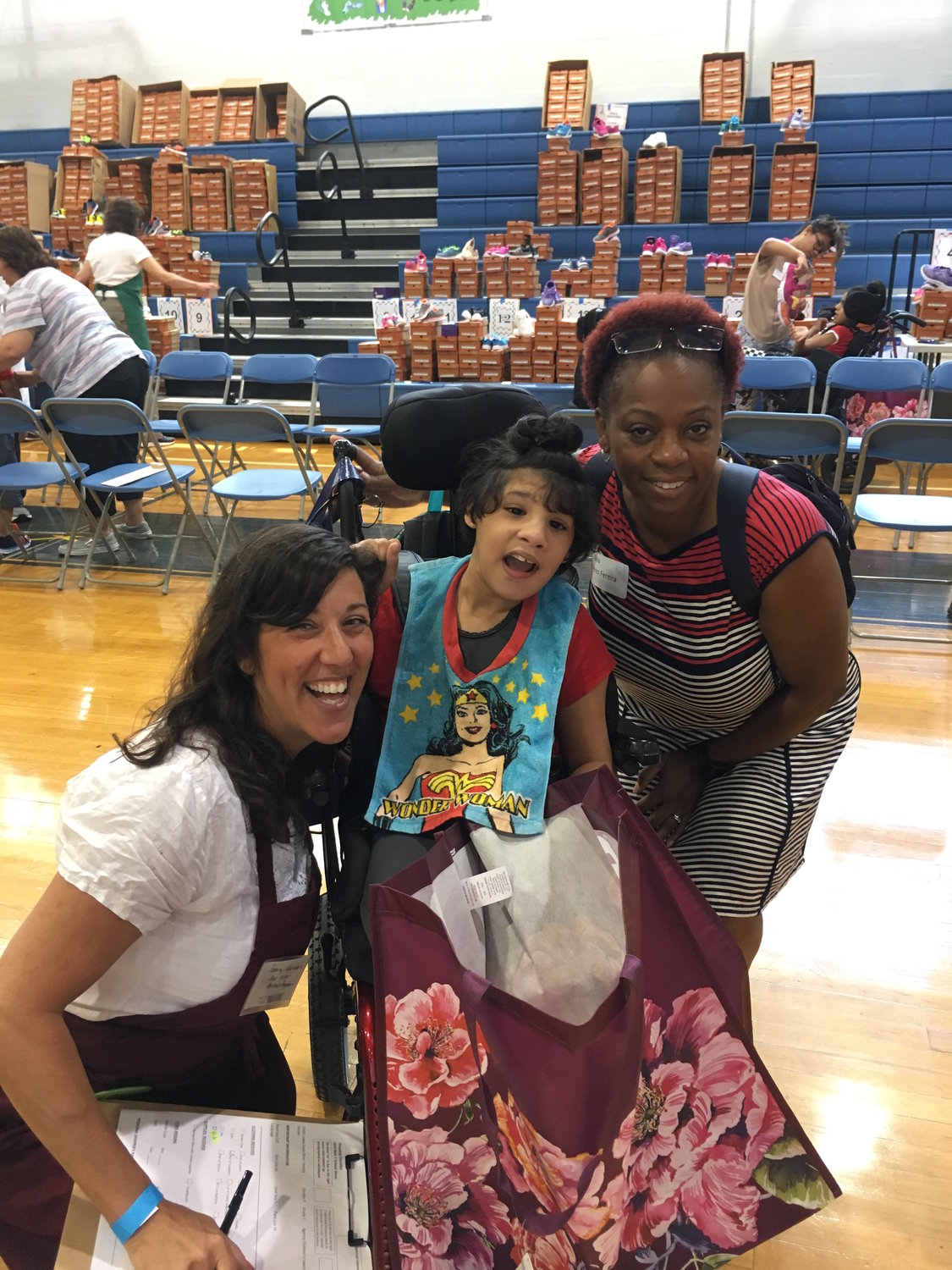 Volunteer shopper Tammy Washington helped Kayla, center, and Perez Fereira  at the NCJW Back 2 School Store on July 28.