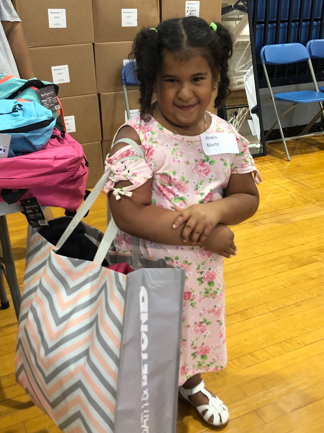 Analis appeared proud of her shopping experience at the Back 2 School store.