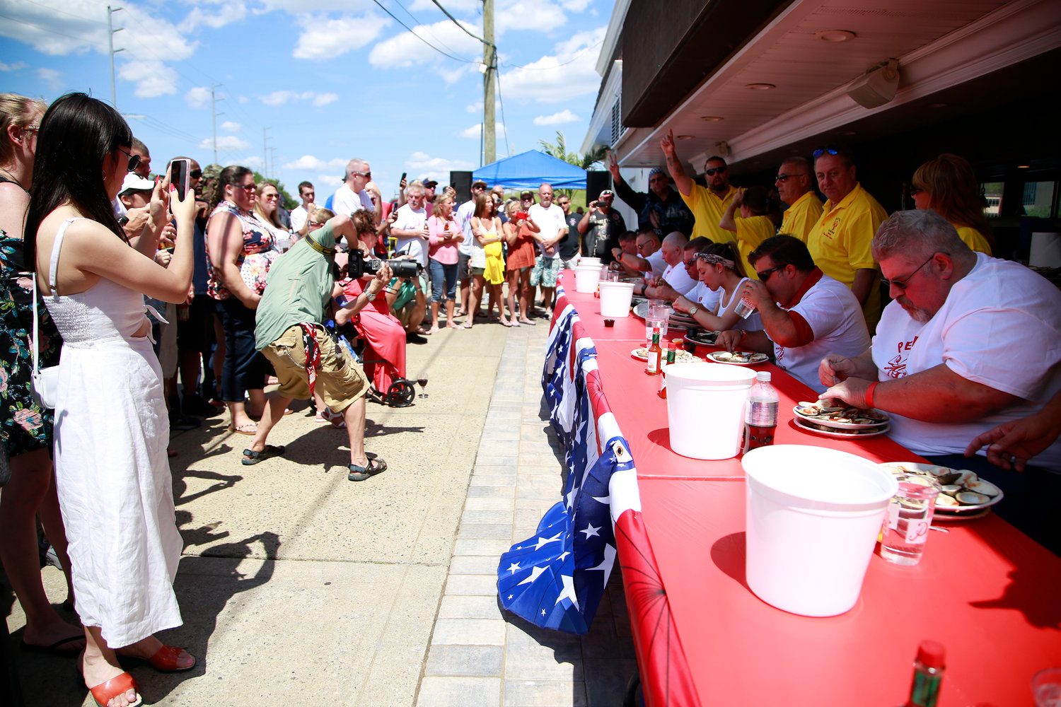 Peter's Clam Bar in Island Park hosted its sixth annual clam-eating contest on Sunday, which was attended by hundreds of participants and spectators.