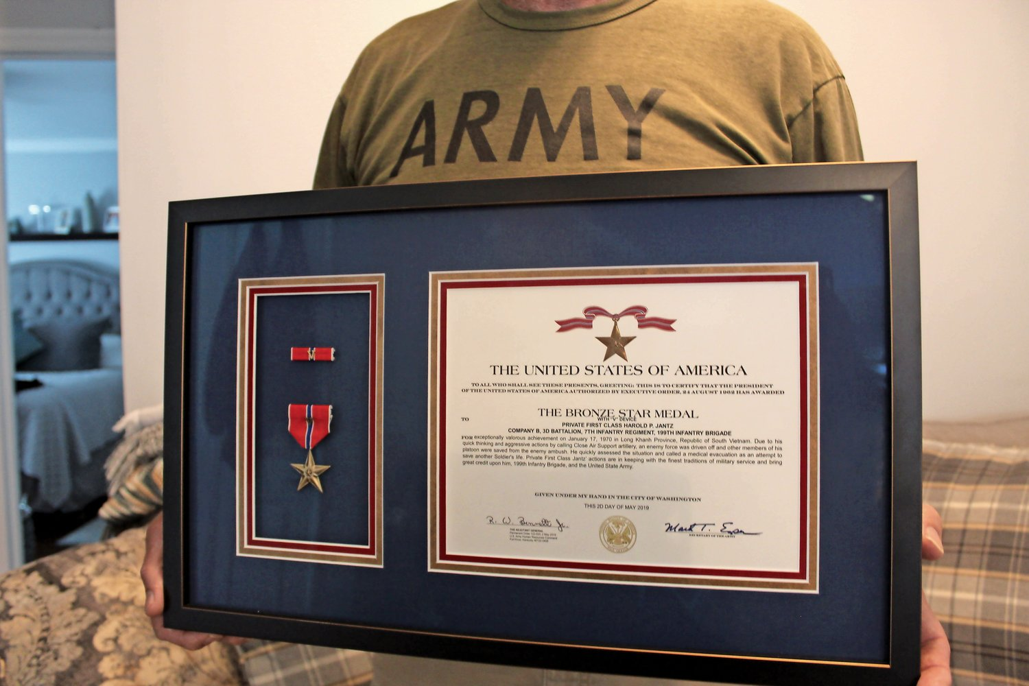 The Bronze Star Medal with valor.