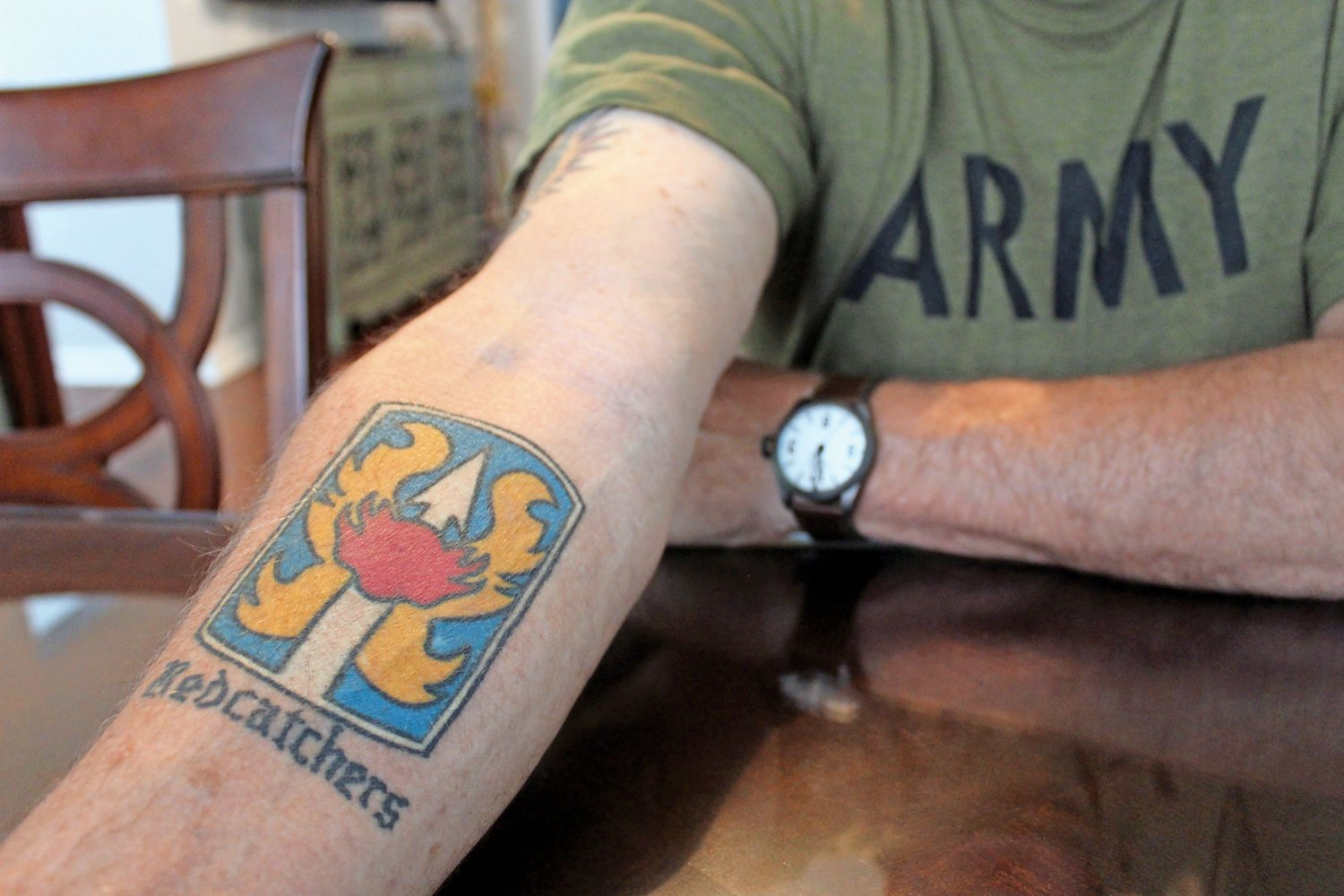 One of Jantz's tattoos is the insignia of the Army's 199th Infantry Brigade, nicknamed the Redcatchers.