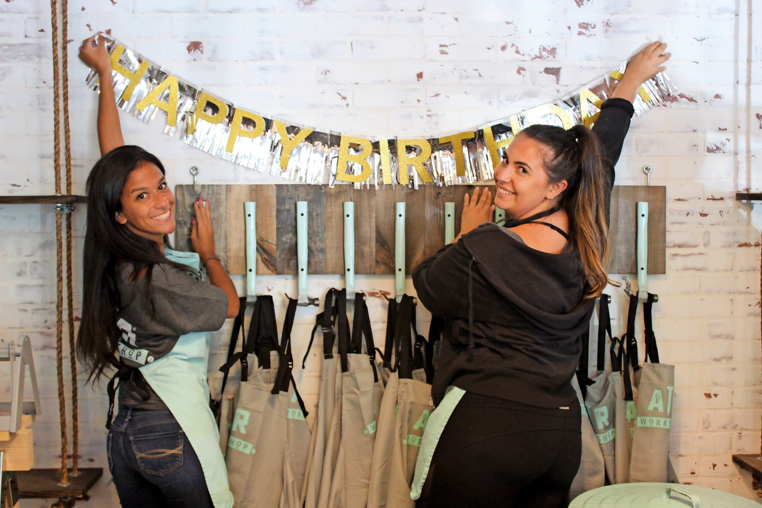 Project assistants Nicolette Diraimondo, left, and Sierra Glicker dressed up the shop in birthday décor.