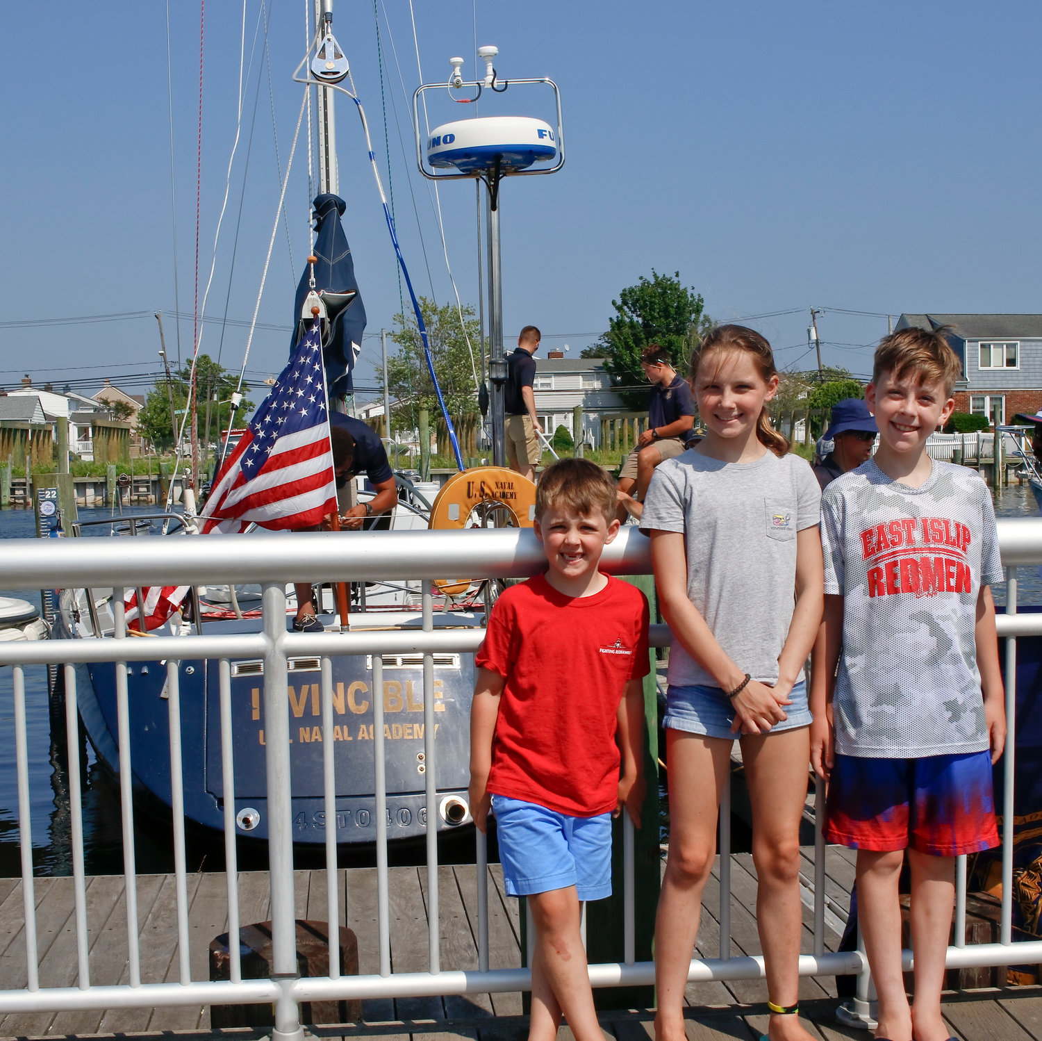 Twenty-one years ago, Freeport native Colleen Minihan, then a Midshipmen, made the inaugural trip from Annapolis to to Freeport. This year, her children, Owen and Page, ages 6 and 11, and their cousin Liam Kennedy, 9, watched this year's arrival.