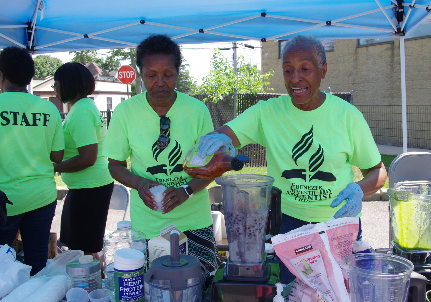 Retired nurse Ruth Burke, right, and health fair volunteer Ina Richards, worked together to make smoothies.