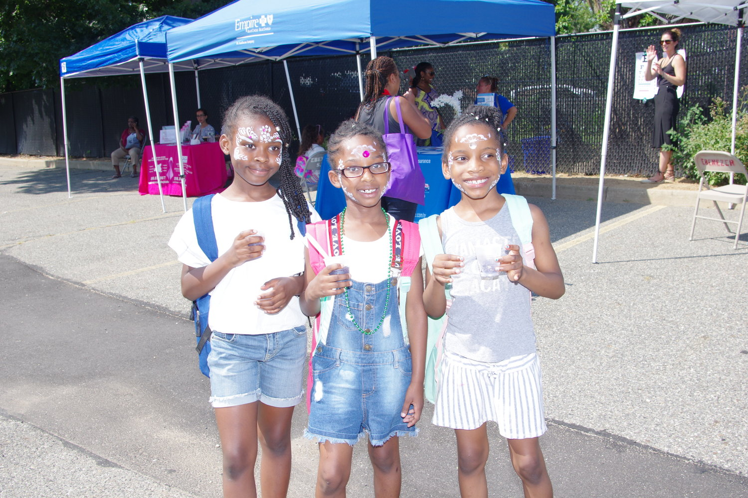 Health Fair attendees, Janay Gray, 9, right, Kylie-Monet Alleyne,7, and Leilani Wachuku, 7,left, enjoyed smoothies after getting their faces painted.