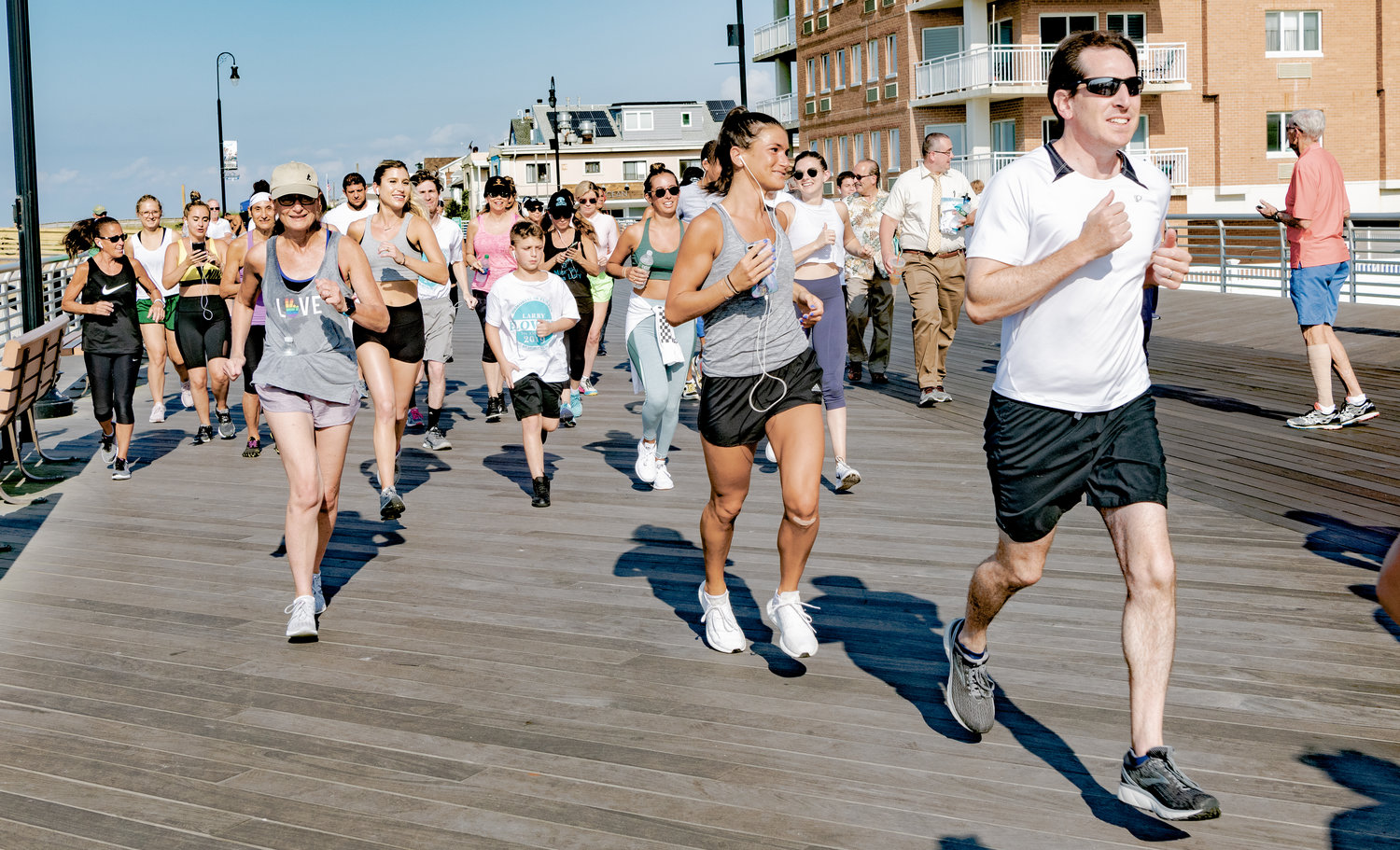 More than 100 people, including State Sen. Todd Kaminsky, right, gathered on the boardwalk at New York Avenue on Aug. 3 for the seventh annual Larry Elovich 5K Memorial Fun Run. The event is hosted each year by the Larry Elovich Scholarship Fund, in cooperation with the city.