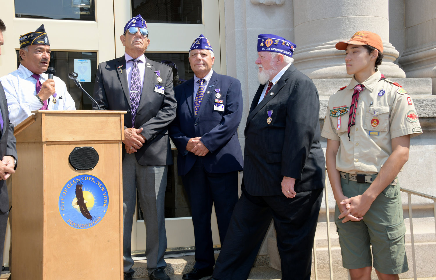 From the left, veteran Tony Jiminez discussed the history of the Purple Heart award along with fellow veterans Robert Chiappone, Tony Sparaco, Erie Mutz and Glen Cove Boy Scout Genalie Prezeau.