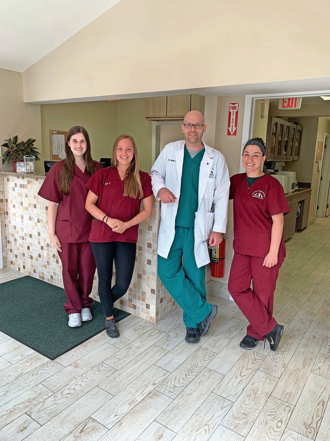 There to help at the Oyster Bay Animal Hospital are receptionists Lauren Pastolove, far left, and Julia Stanwycks, Dr. Jeremy Lancer and veterinary assistant Rita Ripani.