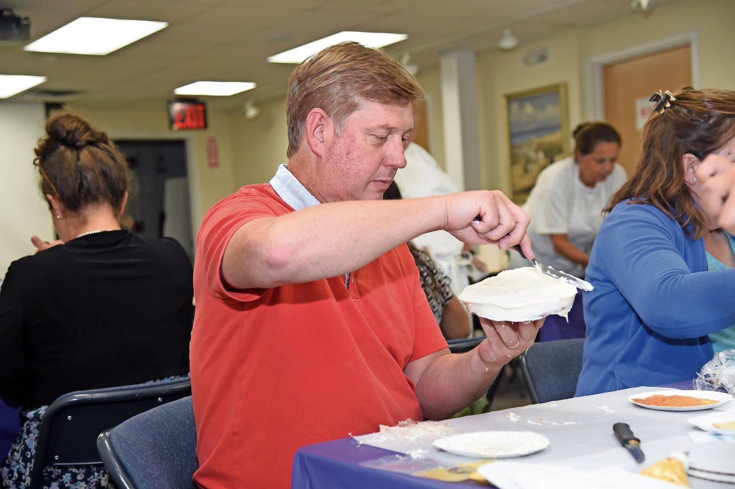 Eric Murdoch added icing to his cake at the Franklin Square library's Adult Cake Decorating class on Aug. 15.