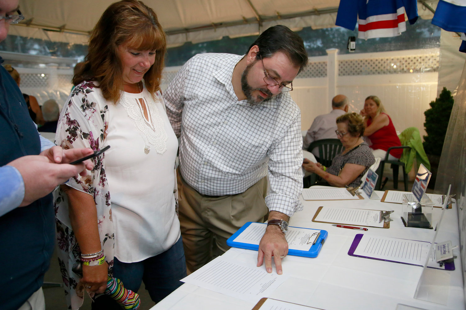 Village Trustee Perry Cuocci and his wife, Ann Marie, browsed through the silent auction items.