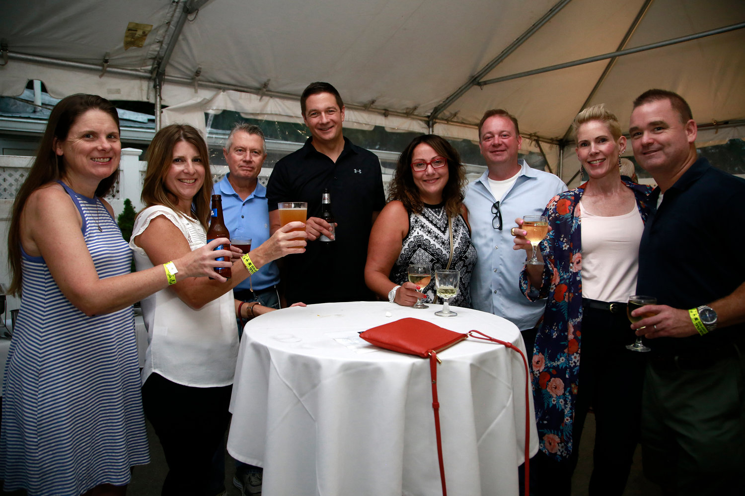 Dawn O'Brien, far left, Jennifer Prizzi, Village Justice James Frankie, Carl Prizzi, Elizabeth and Erin Meade, and Megan and Jimmy Schutta all supported the fundraiser.
