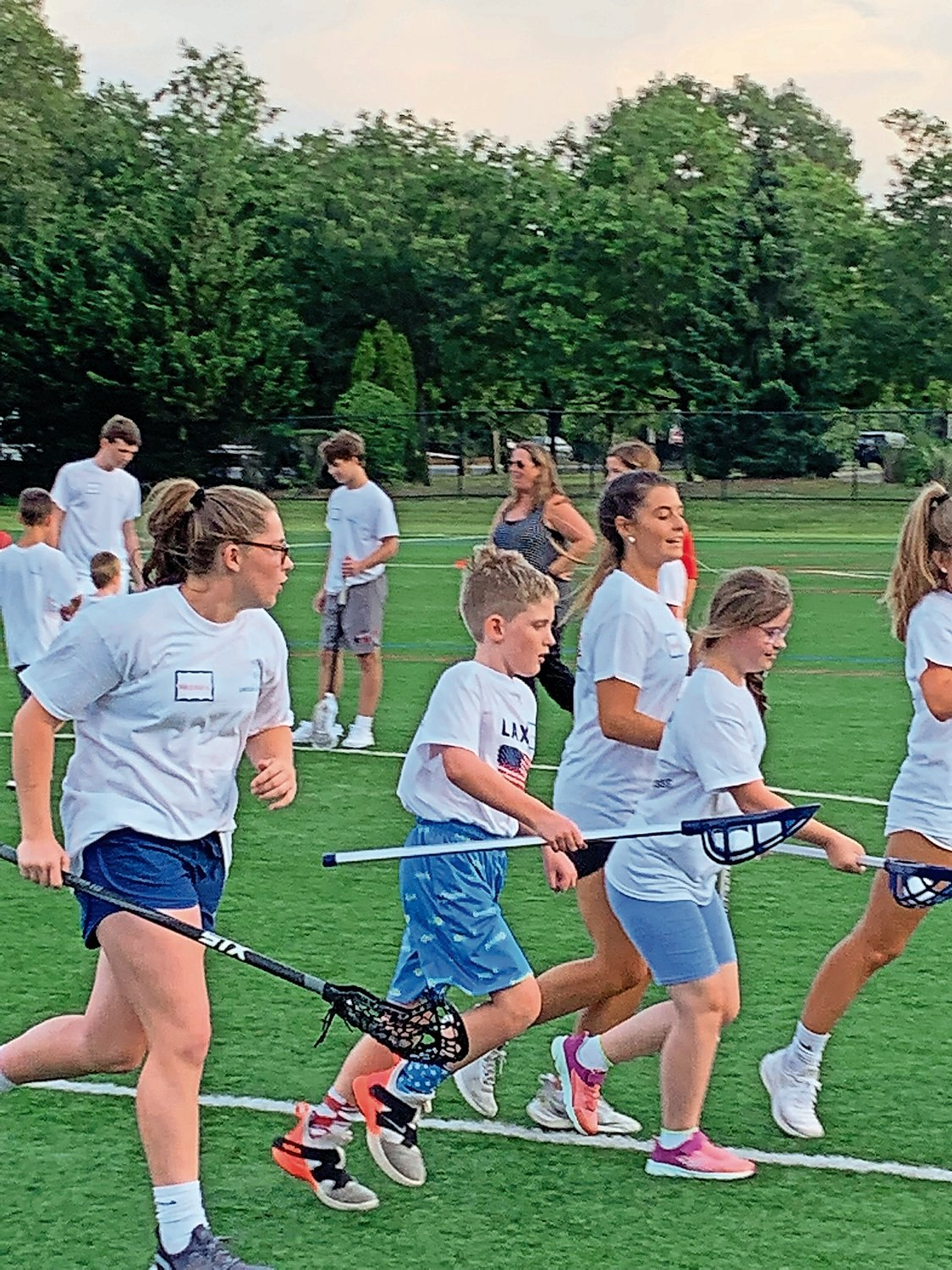 This summer, South Side High School lacrosse players organized a lacrosse clinic for children with special needs. They plan to hold another in September.