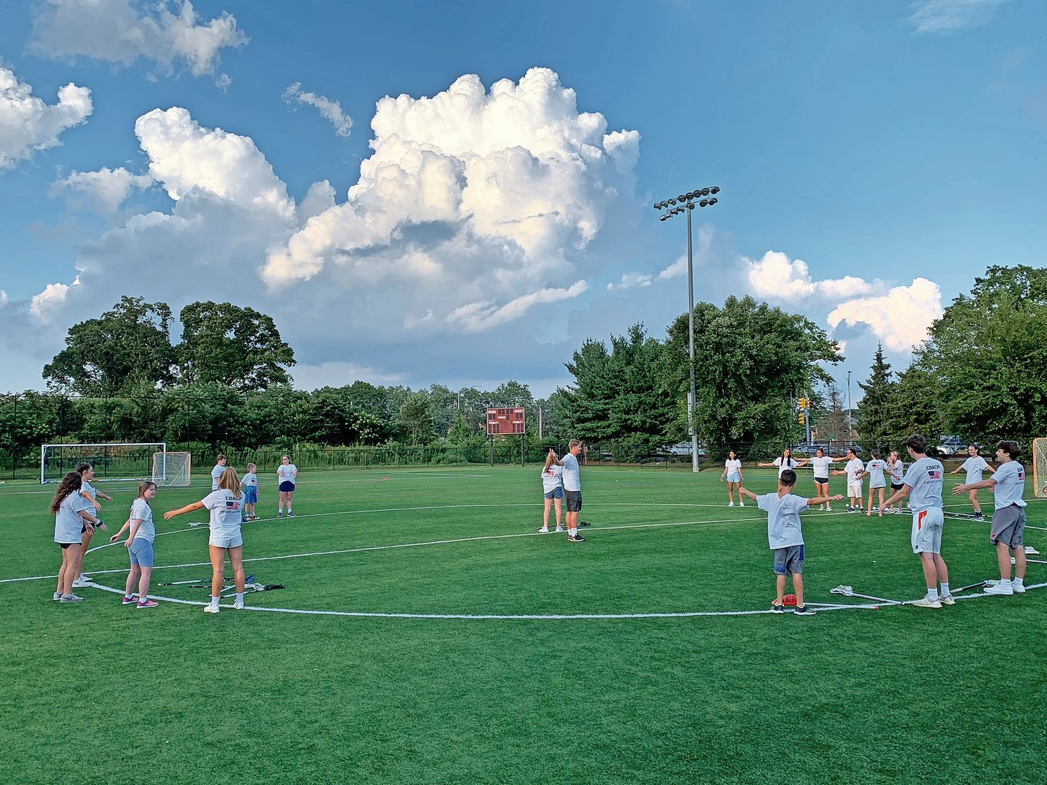 The group played games on the field during the lacrosse clinic.