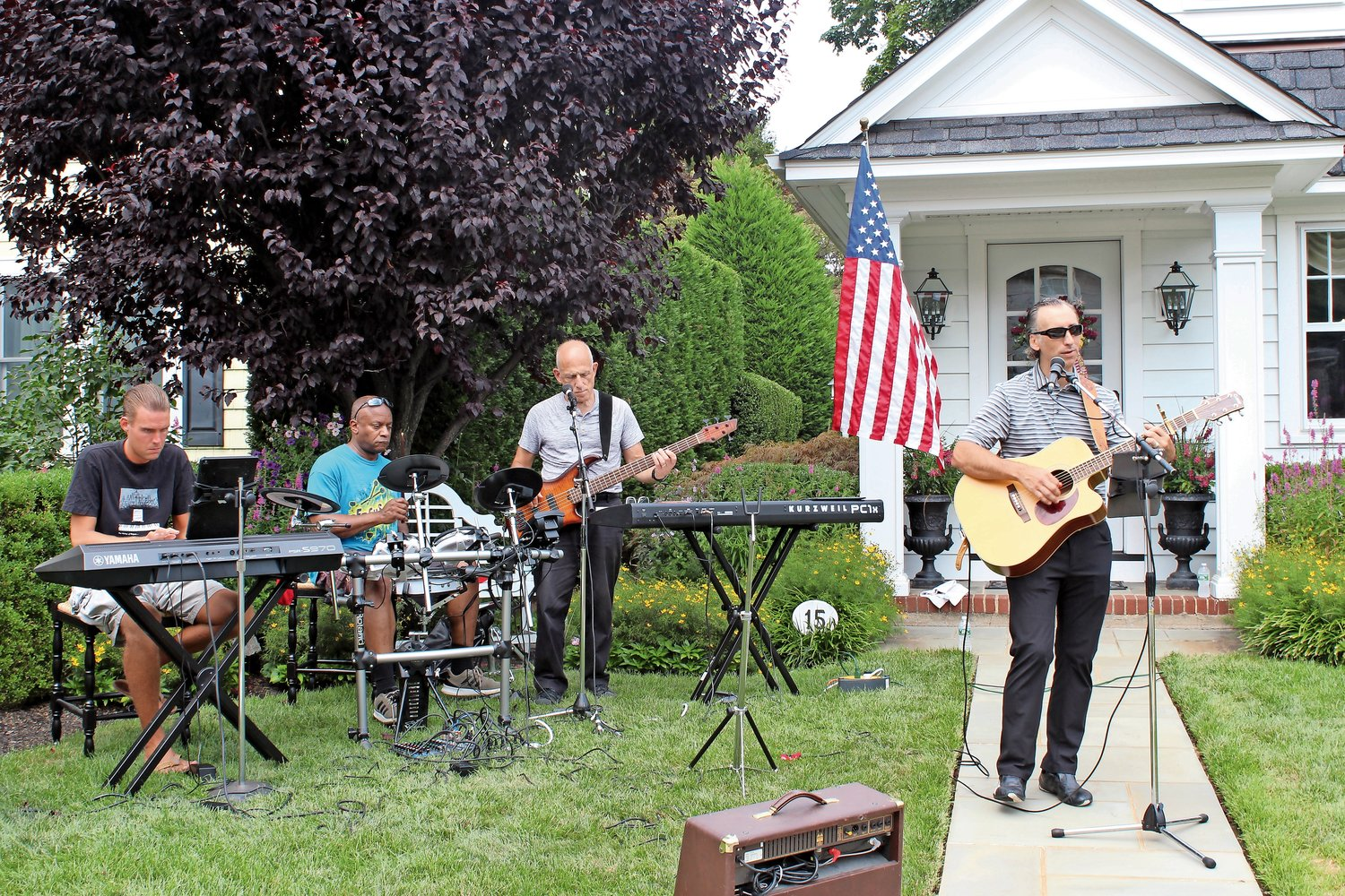 John Tittmann, of West Hempstead, far left above, Brian Carrot, of Valley Stream, Joe Ciccarello, of Malverne, and Brett Crompton, of Floral Park, rehearsed at the Wahligs' home on Wallace Street.