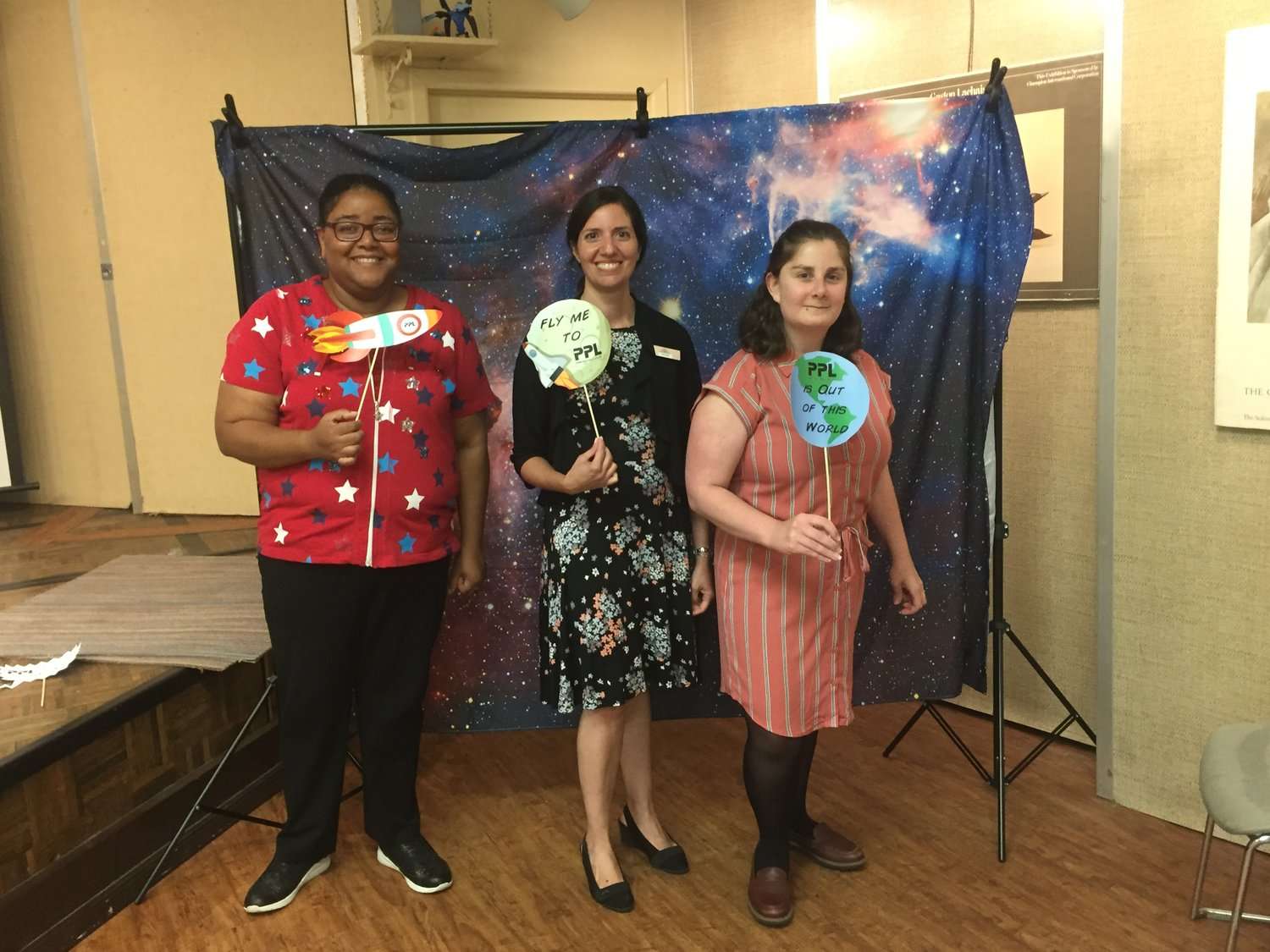 PPL children's librarians Grace Bazille, left, Antoinette Levine and Katie Mirro, right, were overwhelmed by the turnout at the reading program's end of summer party.
