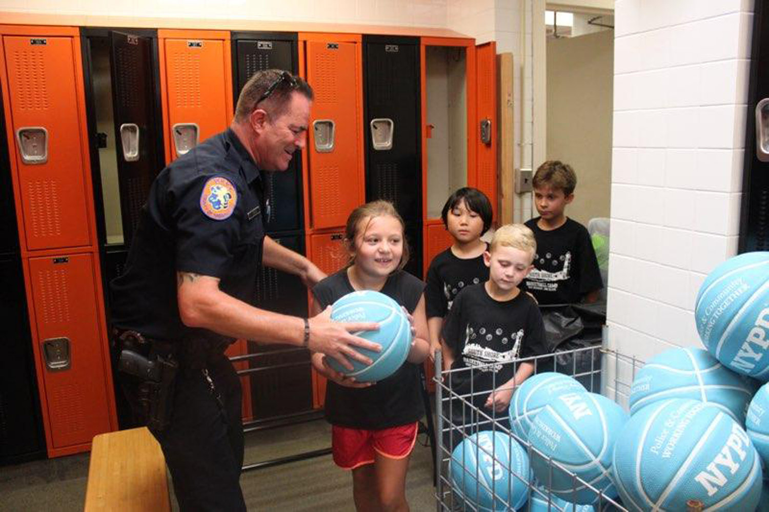Nassau County Police Department Officer Gary Zima handed out the balls to the campers.
