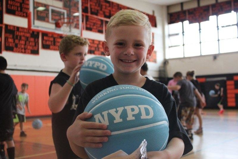 Finn Owens was delighted to receive the gift of a new basketball.