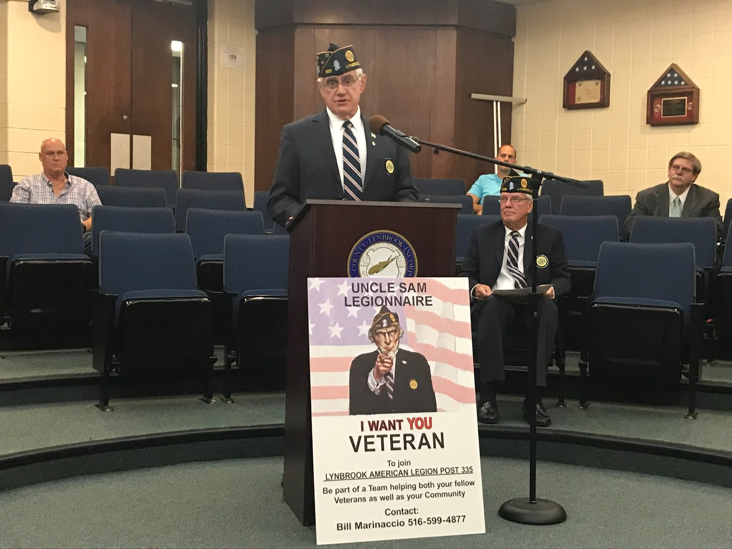 American Legion Post 335 Adjucant Bill Marinaccio, at lectern, and Steve Grogan are spearheading a movement to recruit new members during the post's 100th anniversary.