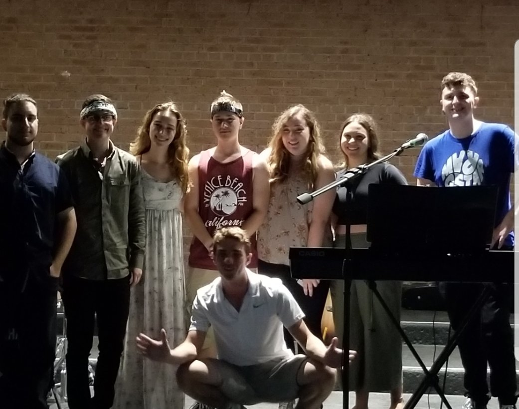 The East Rockaway Recreation Department hosted a Music and Art Showcase in Memorial Park on Aug. 15, where local singers, musicians and artists displayed their talents. Performing at the event were, standing, from left, Phil Perazzo, Joey Powers, Katharine Calabrese, Gale Calabrese, Sophia Bertolotti, Michelle Landerer and Jack Neary, along with Mike Mistretta, center.
