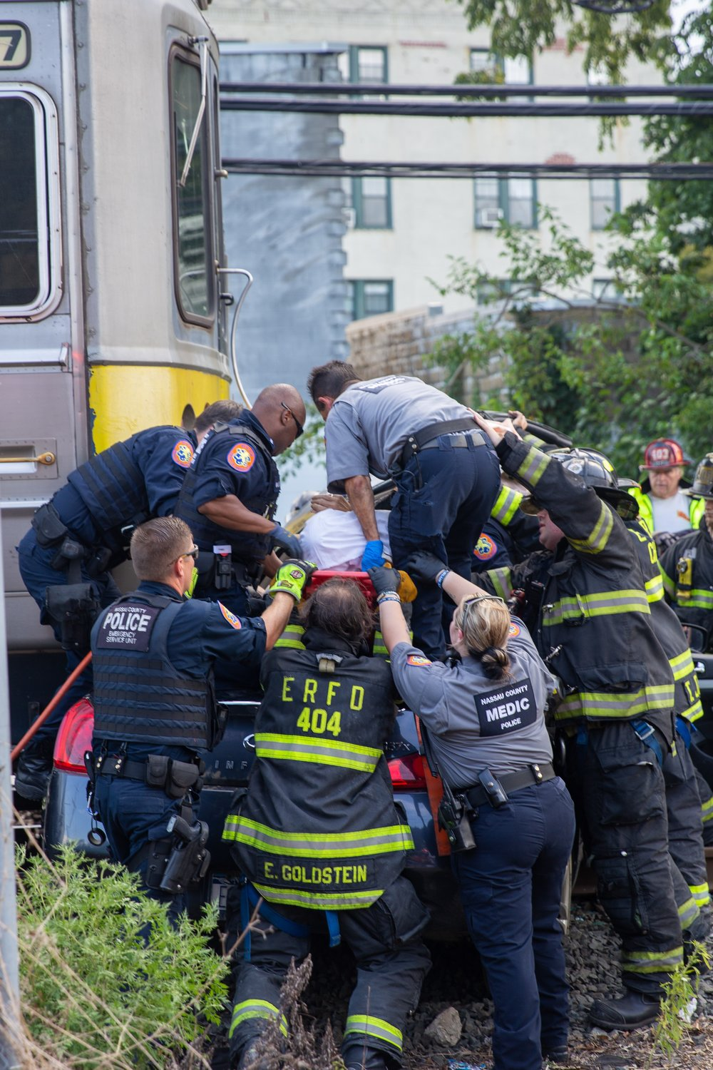 The East Rockaway Fire Department and other emergency crews arrived on the scene to lift the car off the tracks and aid the unidentified driver.