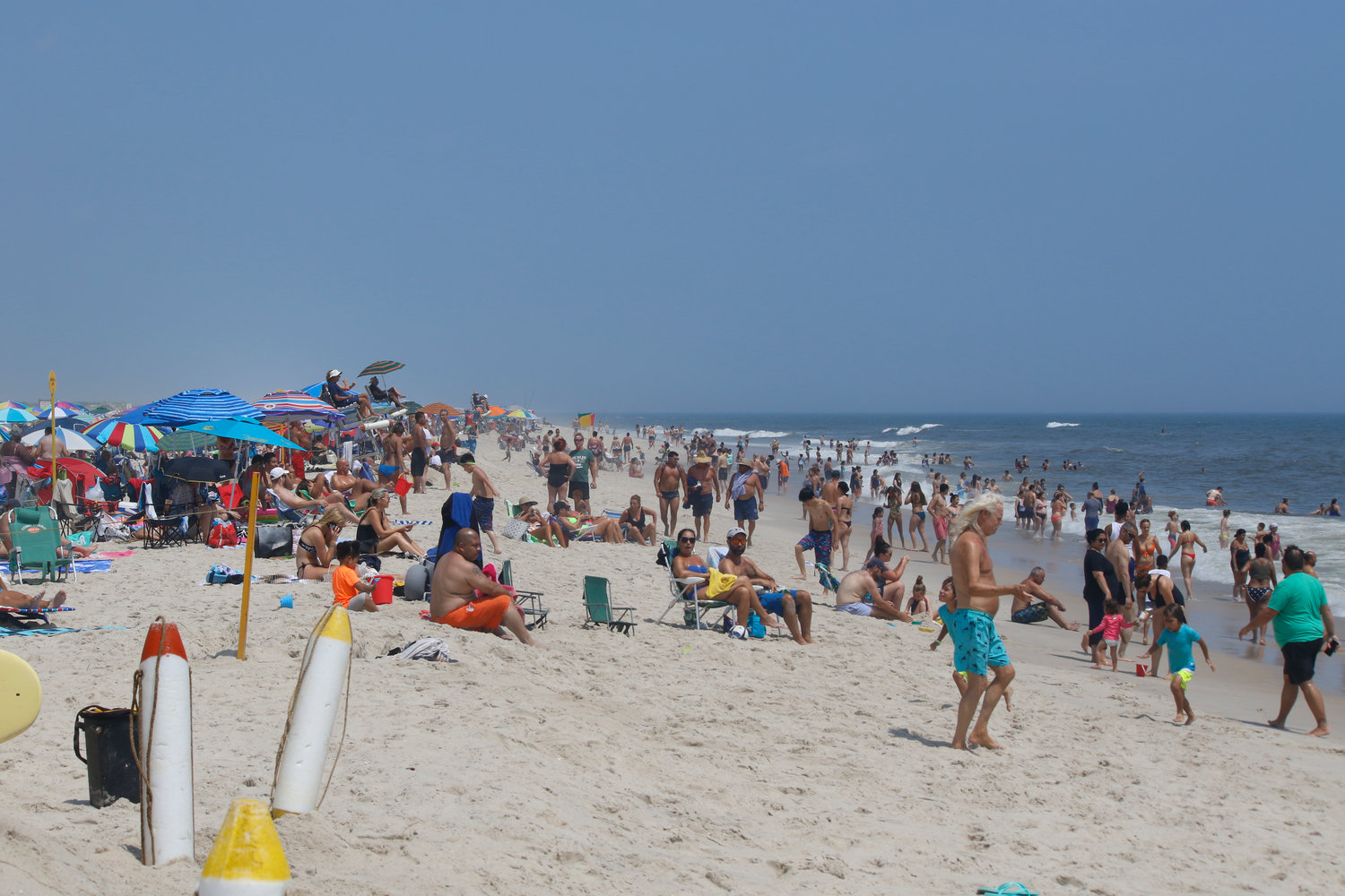 Some of the thousands of visitors who took advantage of cooler beach temperatures to visit Jones Beach State Park during a recent heat wave.