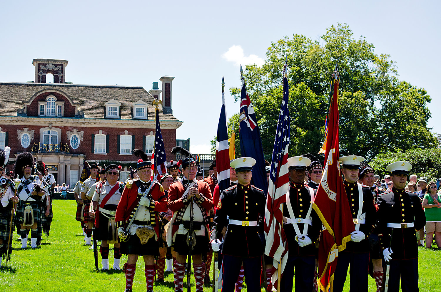 Colorful pipers and drummers prepare to step proudly around the grounds of Old Westbury Gardens honoring a cherished heritage.