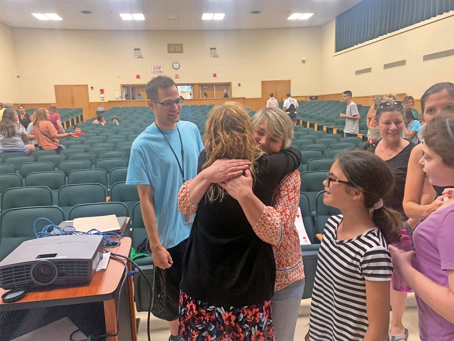 After the credits rolled, parents and teachers embraced Brickmeier, right, thanking her and her son for their efforts.