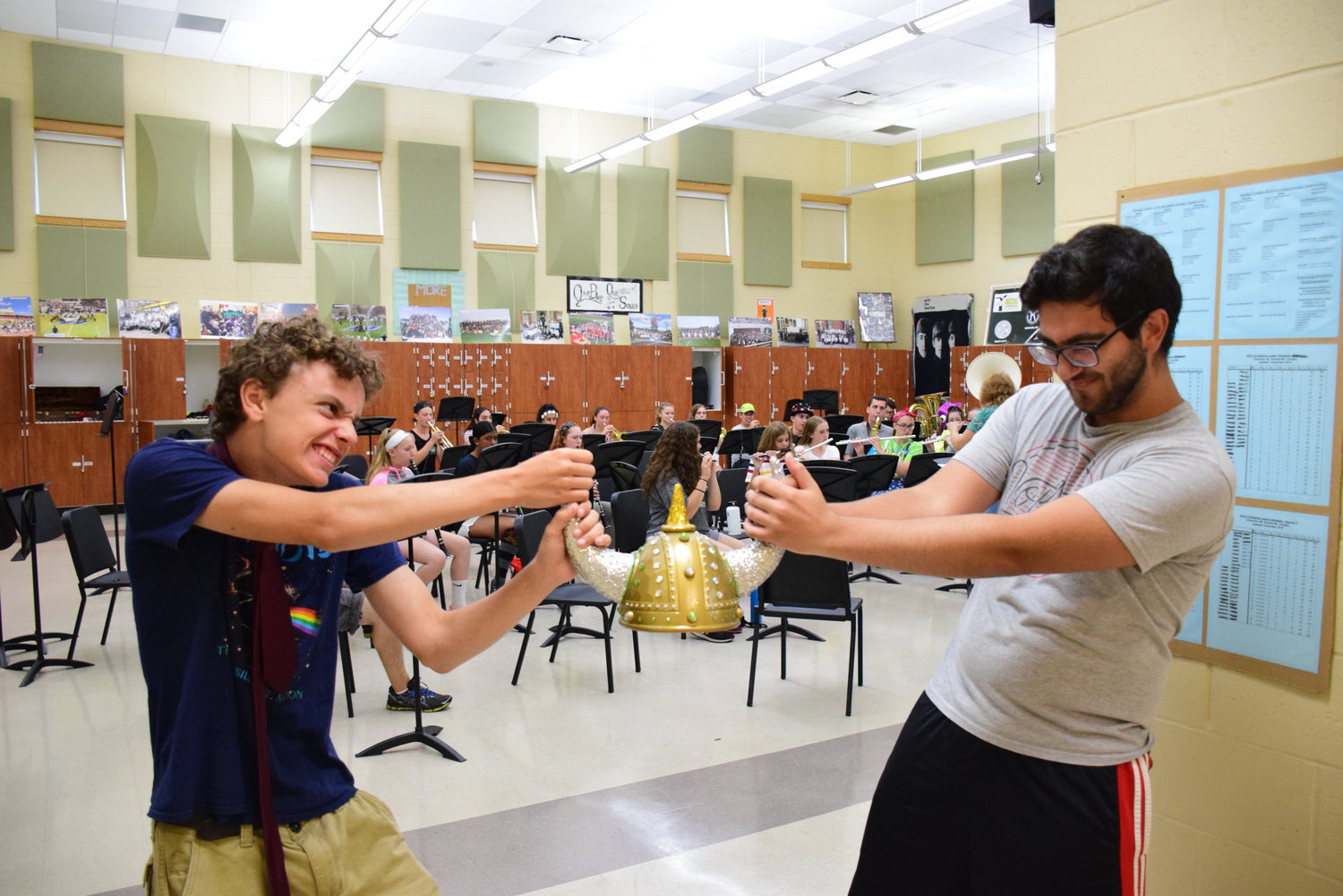 Drum majors Andrew Calvacca, left, And Pablo Hashem battled for the jewel-encrusted Viking helmet that is at the center of this year's show.