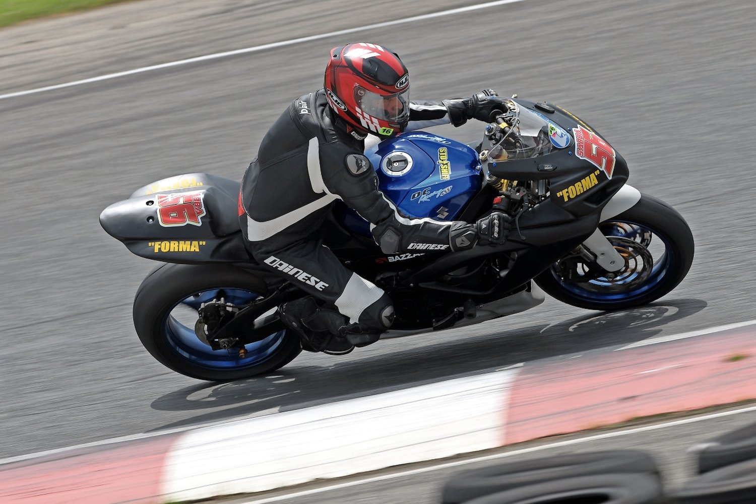 Motorcycle club racer Ron Rabinovich, of Merrick, couldn't escape the click of a camera while racing on the track at New Jersey Motorsports Park in June. A self-described adrenaline junkie, Rabinovich has raced motorcycles for 10 years.