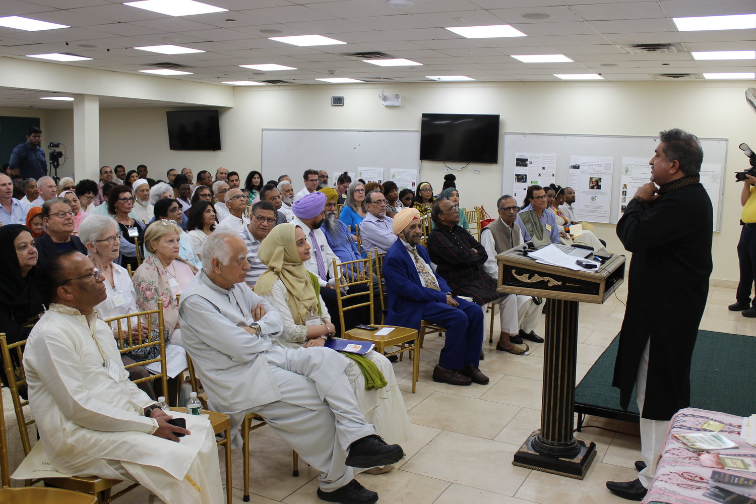 Mohammed Sohail Nabi, a board member of the Islamic Center of Long Island's Interfaith Instutute, explained the history of Mecca, Saudi Arabia, the holiest city in Islam, at the center's interfaith celebration of Eid al-Adha on Sunday.