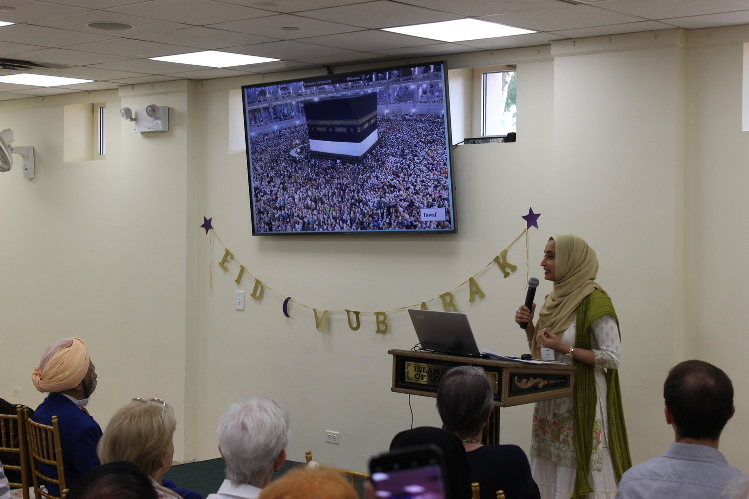 Leading up to the holiday, Muslims from around the world make a pilgrimage to Mecca called the Hajj. Sahar Hussain, right, another ICLI Interfaith Institute board member, made the pilgrimage in 2015, and shared her experience with congregants. She displayed an aerial view of the crowd of worshippers in the center of Mecca's Grand Mosque.