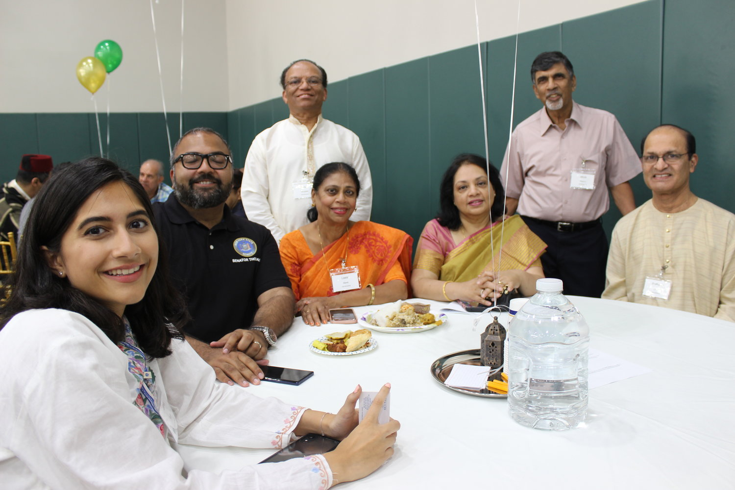 State Sen. Kevin Thomas, in black shirt, enjoyed the feast with, from left, Leena Khan, organizer Unni Mooppan, Leela Maret, Preetha George and her husband, Jacob, and Sudhakar Shetty.