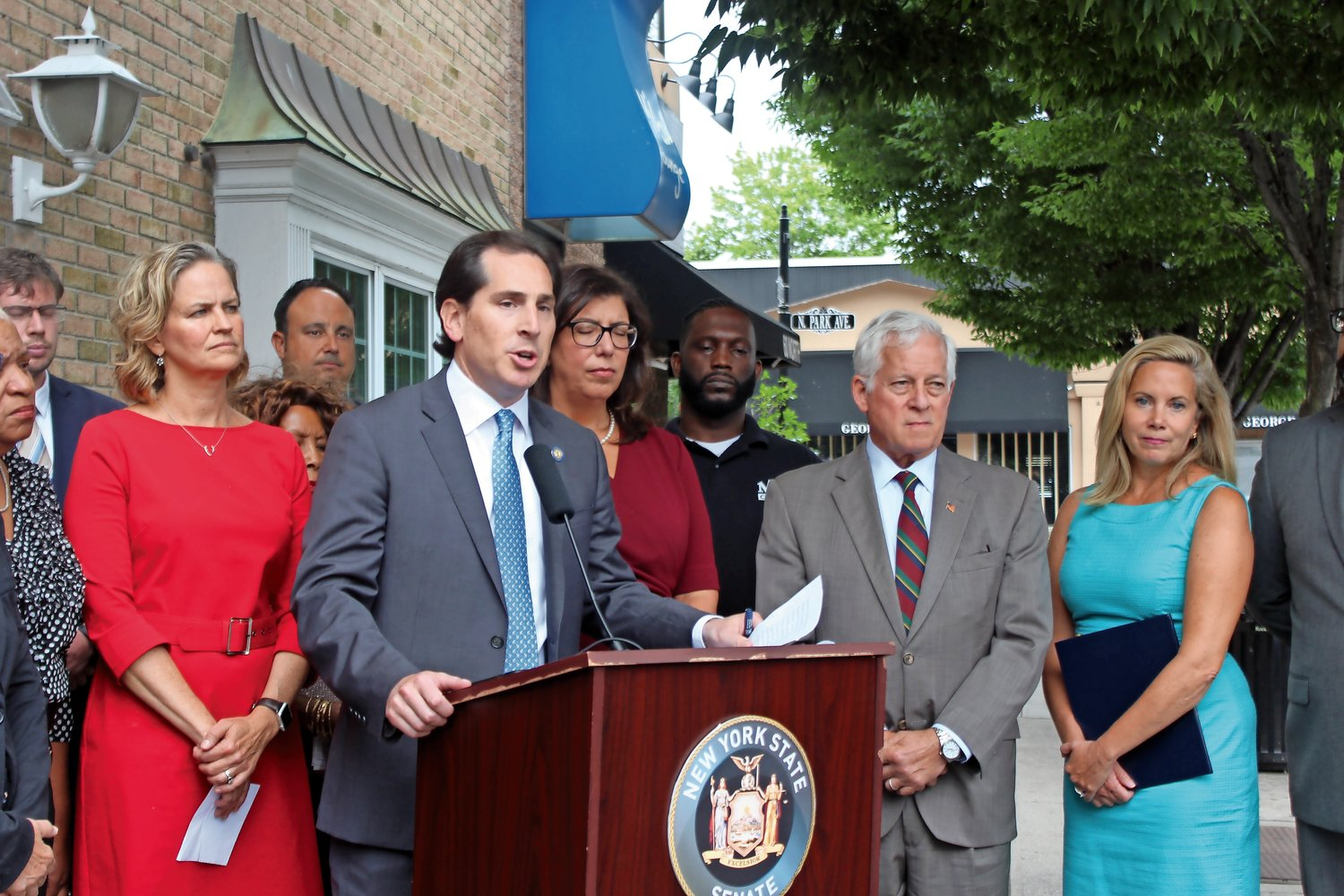 State Sen. Todd Kaminsky, center, and Assemblyman Charles Lavine, right, introduced legislation that would mandate education about the swastika and noose for students in grades six through 12.