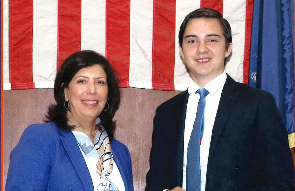 East Meadow High School senior Matt Pienkowski, right, was presented with the SHIELD Award from Nassau County District Attorney Madeline Singas, left, on July 9.