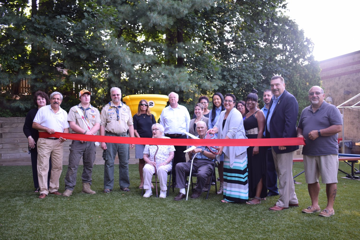 Glen Cove Harbor Child Care Center Director Claudia Recarey cut the ribbon for the opening of the new playground.